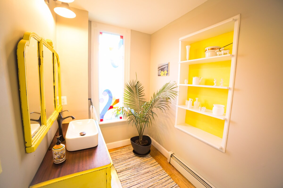 Bathroom with yellow accents
